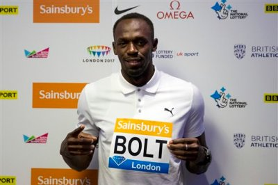 Jamaican sprinter Usain Bolt, the world record holder and Olympic champion in the 100 metres and 200 metres, poses for photographers at the end of a press conference in a hotel, ahead of competing in the Diamond League athletics meeting at the Olympic Stadium in London, Thursday, July 23, 2015. (AP Photo/Matt Dunham)