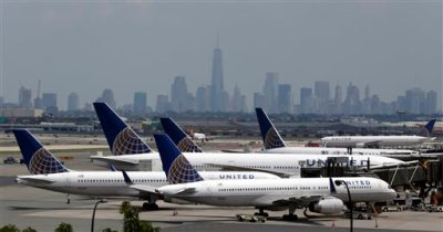 """In this Tuesday, July 22, 2014, file photo, United Airlines jets are parked on the tarmac at Newark Liberty International Airport, in Newark, N.J. All United Continental flights in the U.S. were grounded Wednesday morning, July 8, 2015, due to computer problems. United said in a statement that it is working to resolve the problems, which are related to """"network connectivity."""" (AP Photo/Julio Cortez, File)"""