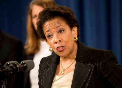In this June 18, 2015, file photo, Attorney General Loretta Lynch speaks at a news conference at the Justice Department in Washington. Lynch announced that Dylann Roof, the man accused of slaying of nine black church members in Charleston last month was indicted July 22, on 33 federal counts, including hate crimes, firearms violations and obstructing the practice of religion, which could include the death penalty. (AP Photo/Pablo Martinez Monsivais, File)