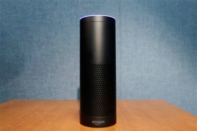 Amazon's Echo, a digital assistant that can be set up in a home or office to listen for various requests, such as for a song, a sports score, the weather, or even a book to be read aloud, is shown, Wednesday, July 29, 2015 in New York. The $180 cylindrical device is the latest advance in voice-recognition technology that's enabling machines to record snippets of conversation that are analyzed and stored by companies promising to make their customers' lives better. (AP Photo/Mark Lennihan)