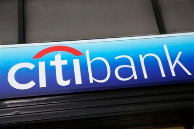 "In this Jan. 15, 2015 photo, a Citibank sign hangs above a branch office in New York. The Consumer Financial Protection Bureau on Tuesday, July 21, 2015 said that Citi will have to issue refunds to 8.8 million affected consumers who paid for credit card add-on products and services, like credit score monitoring or ""rush"" processing of payments. (AP Photo/Mark Lennihan, File)"