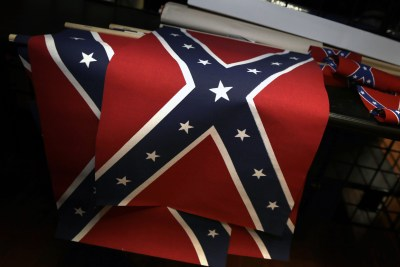 Small Confederate flags are displayed on a shelf at Arkansas Flag and Banner in Little Rock, Ark., Tuesday, June 23, 2015. Major retailers including Amazon, Sears, eBay and Etsy and Wal-Mart Stores Inc., are halting sales of the Confederate flag and related merchandise. (AP Photo/Danny Johnston)