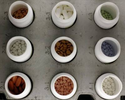 Various prescription drugs on an automated pharmacy assembly line at Medco Health Solutions, in Willingboro, N.J, in 2011. (Matt Rourke/AP Photo)
