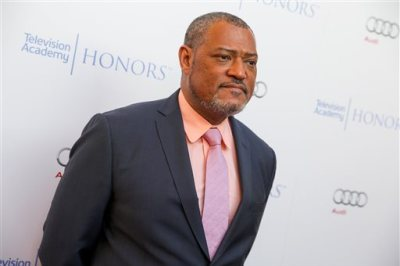 """FILE - In this May 27, 2015 file photo, Laurence Fishburne arrives at the 2015 Television Academy Honors at The Montage Hotelin Beverly Hills, Calif. Fishburne will star as Alex Haley in the  A+E Networks scripted event series, """"Roots."""" (Photo by Rich Fury/Invision/AP, File)"""