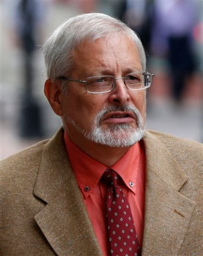 """Michael Geilenfeld arrives at U.S. Bankruptcy Court, Thursday, July 9, 2015, in Portland, Maine. Geilenfeld, an orphanage founder, and Raleigh, North Carolina-based Hearts with Haiti have brought a civil lawsuit against activist Paul Kendrick who they say made reckless allegations and """"vicious attacks"""" that hurt Geilenfeld's fundraising efforts and damaged his reputation. This month, the Haitian National Police arrested Geilenfeld on charges of indecent assault and conspiracy, dramatically cuffing him at the orphanage in Port-au-Prince and hauling him away in the bed of a pickup truck. (AP Photo/Robert F. Bukaty)"""