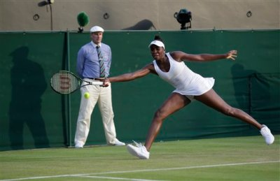 Venus Williams of the United States returns a shot to Yulia Putintseva of Kazakhstan  during their singles match at the All England Lawn Tennis Championships in Wimbledon, London, Wednesday July 1, 2015. (AP Photo/Pavel Golovkin)