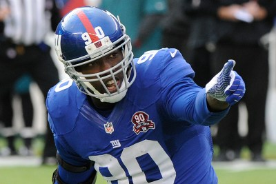New York Giants' Jason Pierre-Paul (90) reacts after sacking Philadelphia Eagles' Mark Sanchez during the first half of an NFL football game Sunday, Dec. 28, 2014, in East Rutherford, N.J. (AP Photo/Bill Kostroun)