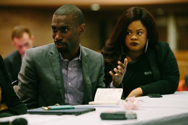DeRay McKesson and Johnetta Elzie meet with Secretary of Education Arne Duncan in Ferguson. (U.S. Department of Education/CC BY 2.0)
