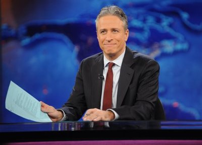 """This Nov. 30, 2011 file photo shows television host Jon Stewart during a taping of """"The Daily Show with Jon Stewart"""" in New York. Stewart says goodbye on Thursday, Aug. 6, 2015, after 16 years on Comedy Central's """"The Daily Show"""" that established him as America's foremost satirist of politicians and the media. (AP Photo/Brad Barket, File)"""