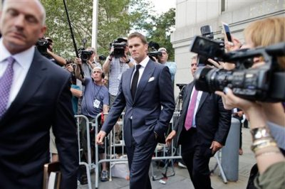 New England Patriots quarterback Tom Brady leaves federal court Wednesday, Aug. 12, 2015, in New York. Brady left the courthouse after a full day of talks with a federal judge in his dispute with the NFL over a four-game suspension. (AP Photo/Frank Franklin II)