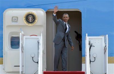 "President Barack Obama waves from the top of the steps of Air Force One at Andrews Air Force Base in Md., Thursday, Aug. 27, 2015, before traveling to New Orleans for the 10th anniversary of Hurricane Katrina. Obama says New Orleans is ""moving forward"" a decade after Hurricane Katrina dealt it a devastating blow, and has become an example of what can happen when people rally around each other to build a better future out of the despair of tragedy. (AP Photo/Susan Walsh)"