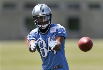 Detroit Lions wide receiver Ryan Broyles catches a ball during NFL football practice in Allen Park, MIch., Tuesday, June 3, 2014. (AP Photo/Paul Sancya)