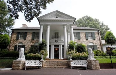 This August 2010 file photo, shows Graceland, Elvis Presley's home in Memphis, Tenn. Over a hundred authenticated artifacts are up for auction Thursday, Aug. 13, 2015, as part of Elvis Week at Graceland. (AP Photo/Mark Humphrey, File)