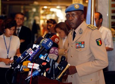 In an Aug. 2012 file photo, General Babacar Gaye, head of the United Nations Supervision Mission in Syria (UNSMIS), gives a news conference in Damascus, Syria. Gaye, the head of the U.N. peacekeeping mission in the Central African Republic, resigned Wednesday, Aug. 12, 2015, at the request of U.N. Secretary-General Ban Ki-moon, over the force's handling of a series of sexual and other misconduct allegations. Ban Ki-moon has called a special session of the U.N. Security Council for Thursday over the issue of sexual abuse allegations that has rocked the world body. (AP Photo/Salman Muzaffar, File)