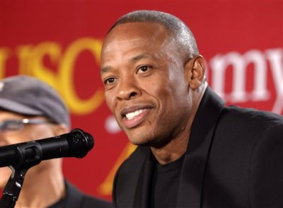 """This May 15, 2013 file photo shows hip-hop mogul Dr. Dre as he announces a $70 million dollar donation to create the new """"Jimmy Iovine and Andre Young Academy for Arts and Technology and Business Innovation,"""" at the University of Southern California, in Santa Monica, Calif.  Dr. Dre says he will donate his royalties from his new album to the city of Compton for a new performing arts facility. """"Compton: A Soundtrack by Dr. Dre"""" will be released Friday, Aug. 7. The album was inspired by the N.W.A. biopic """"Straight Outta Compton,"""" in theaters Aug. 14. (AP Photo/Damian Dovarganes, File)"""