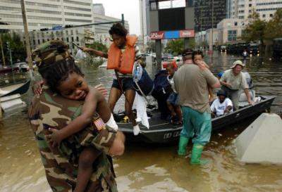 National Guard member Sgt. Ricky Wheelington (left) holds Tyrone Allen, 2, as he arrives for shelter at the Louisiana Superdome in New Orleans in the aftermath of Hurricane Katrina. Around 26,000 people took shelter in the Superdome as the hurricane made landfall. (Melissa Phillip/AP Photo)