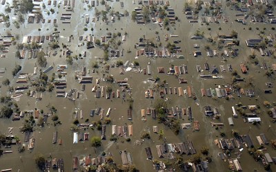 Water engulfs homes just east of downtown New Orleans, the day after Hurricane Katrina made landfall. (AP Photo)