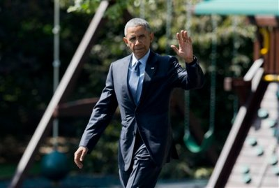 President Barack Obama, waves as he leaves the White House in Washington, Wednesday, Sept. 9, 2015.   Obama is teaming up with Dr. Jill Biden, the wife of the vice president and a community college teacher, to visit Macomb County Community College in Warren, Michigan, on Wednesday. They planned to announce an independent College Promise Advisory Board, led by Biden, that will highlight existing programs providing free community college. (AP Photo/Manuel Balce Ceneta)
