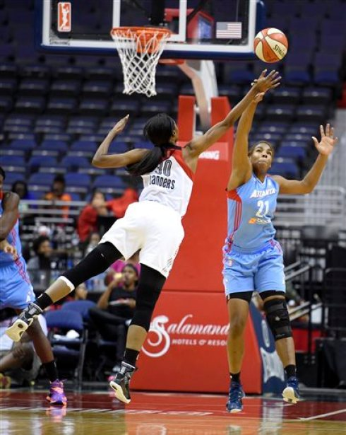 Washington Mystics forward LaToya Sanders (30) battles for the ball against Atlanta Dream forward Reshanda Gray (21) during the first half of an WNBA basketball game, Sunday, Sept. 13, 2015, in Washington. (AP Photo/Nick Wass)