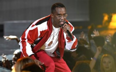 "In this Sunday, June 28, 2015 file photo, Sean ""Diddy"" Combs performs at the BET Awards at the Microsoft Theater in Los Angeles. A spokesman for the Los Angeles City Attorney's Office said on Wednesday, Sept. 9, 2015, that an Oct. 15, 2015 hearing, known as an informal conference, has been set to determine whether Combs will face any penalties, ranging from restitution payments and counseling to a possible misdemeanor charge, over a June incident in which police say he wielded a kettlebell at the University of California, Los Angeles.  (Photo by Chris Pizzello/Invision/AP, File)"