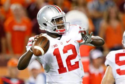 Ohio State quarterback Cardale Jones (12) looks for a receiver during the first half of an NCAA college football game against Virginia Tech in Blacksburg, Va., Monday, Sept. 7, 2015. (AP Photo/Steve Helber)