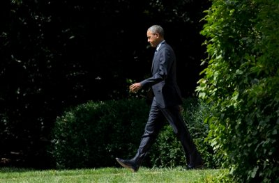 President Barack Obama, walks from the Oval Office of the White House in Washington, Wednesday, Sept. 9, 2015.  Obama is teaming up with Dr. Jill Biden, the wife of the vice president and a community college teacher, to visit Macomb County Community College in Warren, Michigan, on Wednesday. They planned to announce an independent College Promise Advisory Board, led by Biden, that will highlight existing programs providing free community college. (AP Photo/Manuel Balce Ceneta)