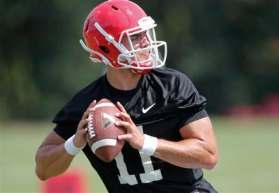 This Aug. 4, 2015, file photo, shows Georgia quarterback Greyson Lambert during a college football practice in Athens, Ga. One year ago, Greyson Lambert was on his way to starting nine games at Virginia. Now, as a graduate transfer, he is the newly named starting quarterback for No. 9 Georgia _ a fresh beginning that comes with heavy expectations. (AP Photo/John Bazemore, File)