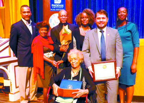 The family of the late Dr. George Brooks, Sr. is presented with a special recognition in honor of his life and work. Mrs. Lula Dora Brooks is seated center. Left to right are Cloves Campbell, Dr. George Brooks, Jr. and wife Angela, daughter Suzanne, Congressman Gallego and Sharee Tavilla. (Danny White/Arizona Informant)