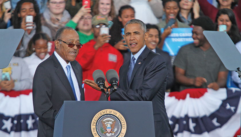 Henry E. Frye, the first African American N.C. Supreme Court Justice, greets President Barack H. Obama, the first African American President of the United States, during a campaign rally for Democratic presidential nominee Hillary R. Clinton, held Tuesday, Oct. 11, at the White Oak Amphitheatre in Greensboro. (Joe Daniels/ Carolina Peacemaker)