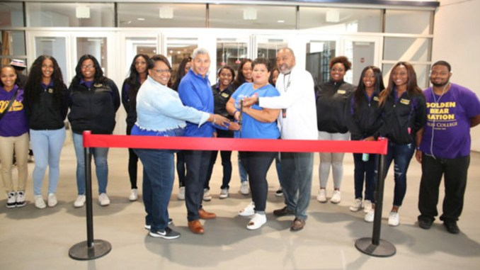 THE CHICAGO FOOTBALL CLASSIC HBCU College Fair officially opens with the cutting of the ribbon by co-sproducers of the event. Pictured from l-r: Taheria Brown from CPS; Chancellor Juan Salgado, City Colleges of Chicago; Letticia Flores Poole from BMO Harris Bank and Larry Huggins, co-founder of the Chicago Football Classic. (Photo credit: Tito Garcia)