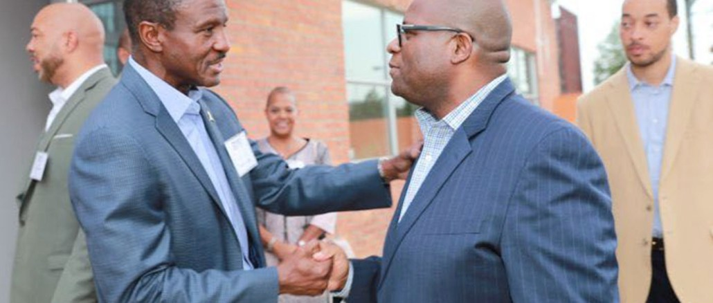 Detroit Pistons head coach chatting with Michigan Chronicle publisher Hiram E. Jackson. PHOTO: Monica Morgan