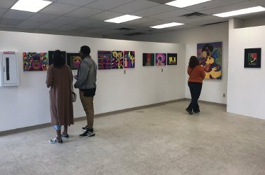Guests at the Spirit of Wakanda Festival tour the Visual Arts Gallery (Photo by Rhea Riley)