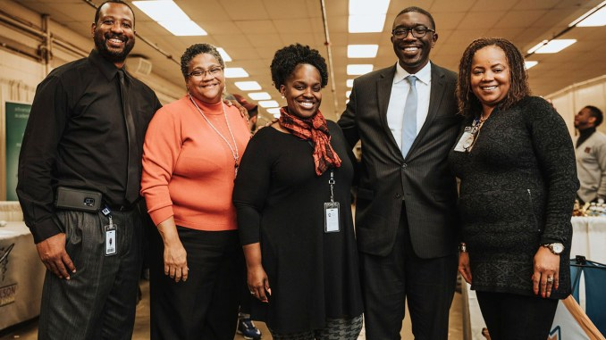Metro Schools director Dr. Shawn Joseph (2nd from right) with four Metro School staffers at School Choice Festival. (photo by Ardee Reyes Chua)