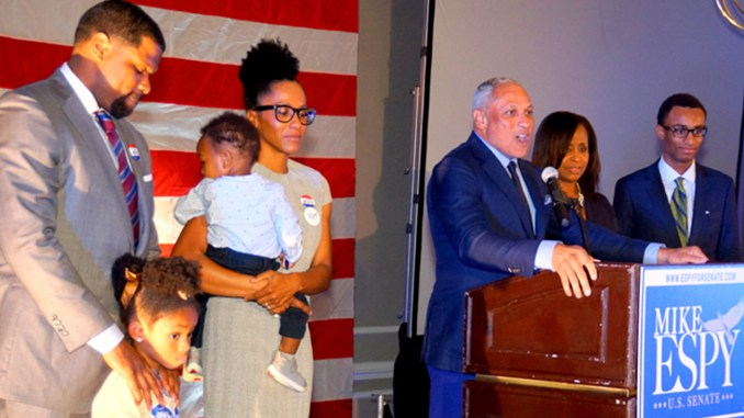 Espy, with family standing with him, addresses supporters on election night at the Hilton Jackson, County Line Road, Jackson, MS