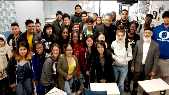 Rev. Jesse Jackson (Second row, third from right) meets with Oakland High School students, Friday, Nov. 30, along with Oakland High Principal Matin Abdel-Qawi (front row, right).