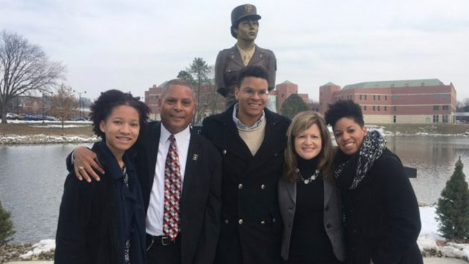 Members of the Murphy-Matthews family stand in front of the statue honoring the 688th U.S. Army Postal Directory Battalion. L to R. Kamryn Matthews-Williams (great grand-daughter), Rodger (son), Rodger M. Matthews (grandson), Carol D. Matthews (spouse of son Rodger Matthews), Dr. Rayna Whetstone (granddaughter).