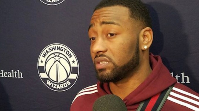 Washington Wizards guard John Wall speaks with reporters after a Dec. 31 practice regarding his upcoming heel surgery, which is expected to keep him out six to eight months. (William J. Ford/The Washington Informer)