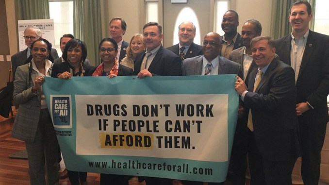 Prince George's County Executive Angela Alsobrooks (front row, second from left) and Maryland leaders pose in support of Prescription Drug Affordability Board, in collaboration with Health Care for All, an organization dedicated to expanding affordable and feasible health insurance and care for all Marylanders. (Courtesy Photo)
