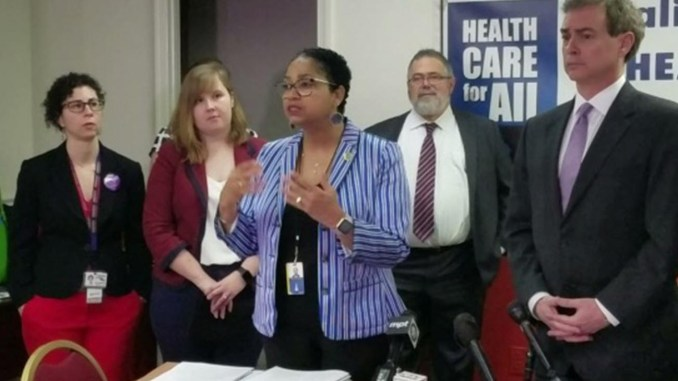 Maryland Delegate Joseline Peña-Melnyk speaks at a Feb. 13 press conference about legislation she and state Sen. Brian Feldman (right) propose to give the state an individual health care mandate. (Photo by: William J. Ford/The Washington Informer)
