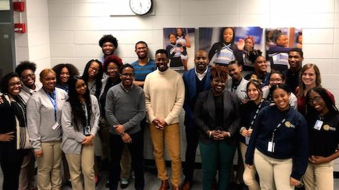 """Baker College Prep Pride """"Bigs,"""" """"Littles"""" and staff pose with the panelists."""
