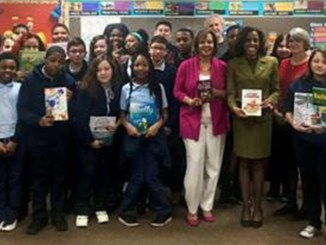 Congresswoman Robin Kelly (center, pink jacket) with students at Sandridge Elementary School in Lynwood, where she personally delivered a 150 books donated from a Library of Congress Surplus Book program.