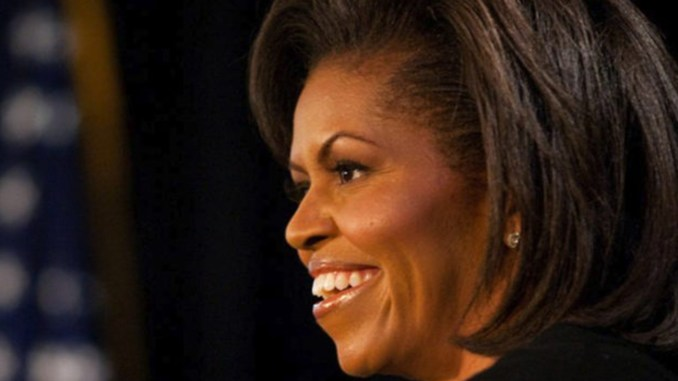 First Lady Michelle Obama addresses a gathering at The Arts Center in Fayetteville, N.C., Thursday, March 12, 2009, on her first official trip as First Lady. She also visited nearby Ft. Bragg.