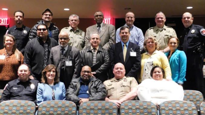 Participants are, from left, front row, MTSU Police Chief Buddy Peaster, Deborah Oleshansky of the Jewish faith, committee member Michael Jones, Sheriff's Major Steve Spence and committee member Tanika Jones; second row, committee members Linell Linell, Rick Rodriguez and Rev. Richard Sibert of Walnut Grove Baptist Church, Saleh Sbenaty of the Islamic Center of Murfreesboro, committee members Steven Scheid, Dawn Rhodes and Irma Rodriguez; back row, MTSU Capt. Jeff Martinez, Aaron Crossley of the Baha'i faith, Sheriff Mike Fitzhugh, Walter Atkinson of the U.S. Department of Justice Community Relations Service, Sheriff's Detective Capt. Britt Reed and Chief Deputy Keith Lowery and Murfreesboro Police Chief Michael Bowen.
