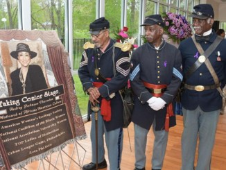 Buffalo Soilders admire a picture of Audrey Patrick Johnson-Thorton (Photo by: Adbul R. Sulayman | Philadelphia Tribune)