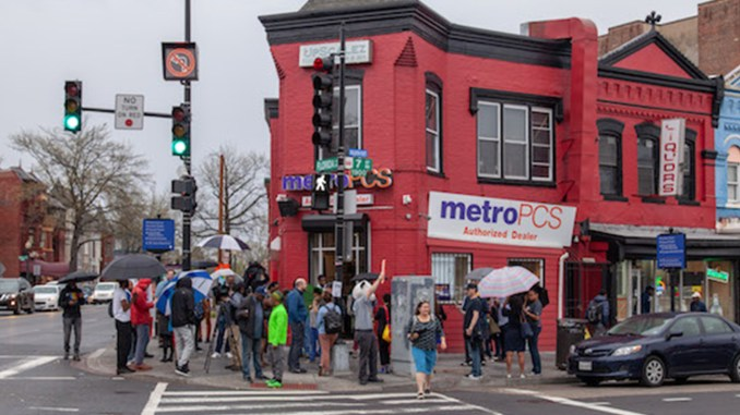 A crowd gathers at MetroPCS on 7th and U streets in northwest D.C. during a protest of a threat from the company's corporate office to shutter the store if the music doesn't stop. (Photo by: Ja'Mon Jackson | WI Bridge)
