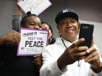 """Russell Simmons takes a selfie with a student from the Community Coalition's Freedom School, during RushCard's """"Keep The Peace"""" initiative at the University of Southern California. (File Photo: Andre L. Perry/Los Angeles Sentinel)"""