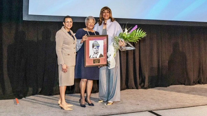 FOUNDER AND PRESIDENT of Ida's Legacy Delmarie Cobb (left) is joined by Faye Wattleton (right) as she presents Dorothy R. Leavell (center) with the Ida B. Wells Legacy Award.