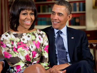 """President Barack Obama and former First Lady Michelle Obama record a message for ABC """"Good Morning America"""" anchor Robin Roberts, in the Library of the White House., February 2013. (Photo: Pete Souza / Wikimedia Commons)"""