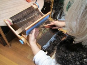Andrea weaving using the Saori technique