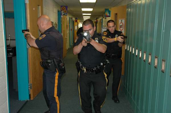 Clearing a school by LMTPD for an active shooter